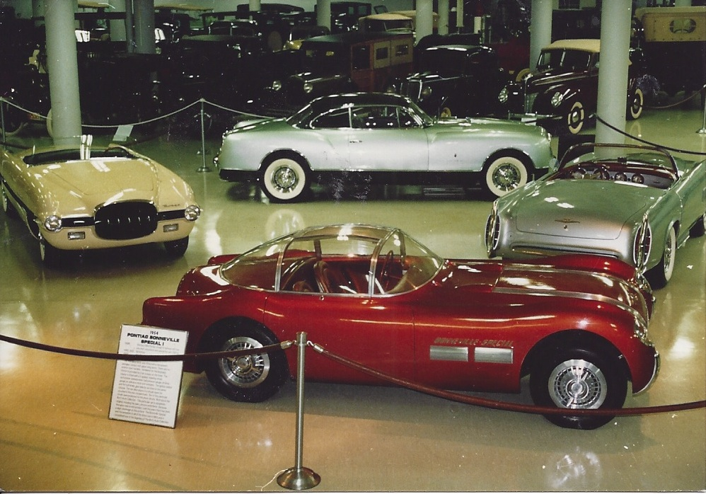 1954 Dodge Firearrow Ghia Roadster (yellow), 1954 Pontiac Bonneville Special (bronze) 1955 Falcon Ghia (blue) and the 1953 Chrysler Ghia Thomas Special (green) on display at the Cleveland Auto & Aviation Museum circa 1993